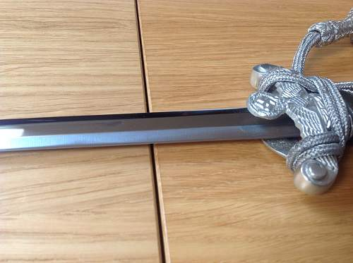 Mint condition Land Customs dagger.