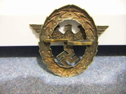 Police hat badge