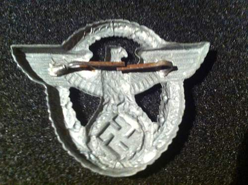 Police hat badge real or fake