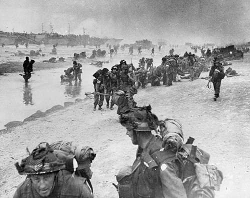The Famous Sword Beach Photo and our Office Cleaner