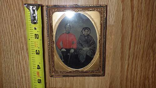 can anyone help me with any info on this old wet on glass photo of mid century british soldier?