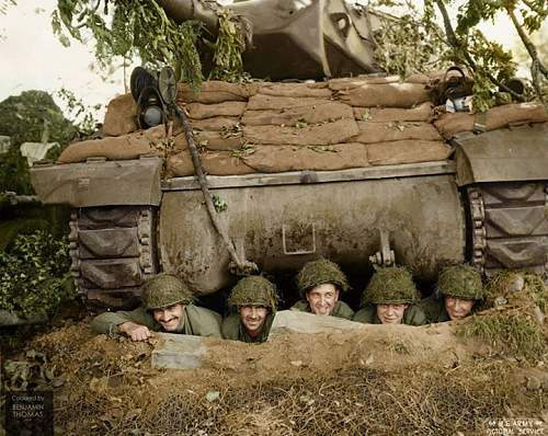 A US tank crew posing for the camera from a foxhole beneath their M-10 26th July 1944