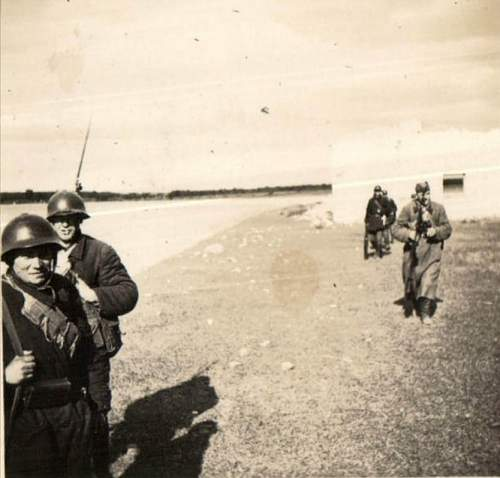 Soviet soldiers wearing SSh-36 helmets