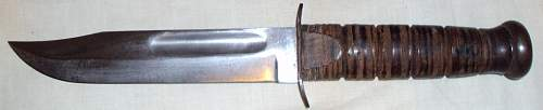 A really nice WWII USMC Kabar with scabbard, but with a really sad story from my marine friend John.