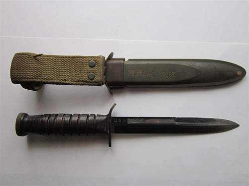 with this USMC fighting knife please.