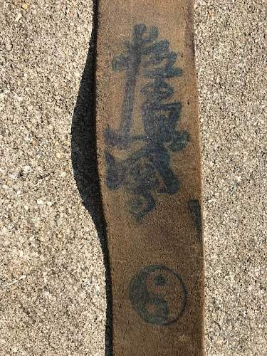 Translation Help with Writing on Belt