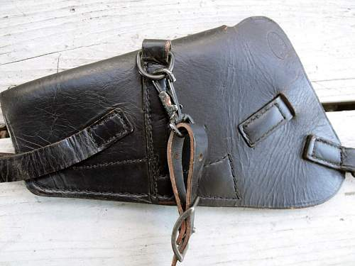 Could anyone help me to identify this holster?