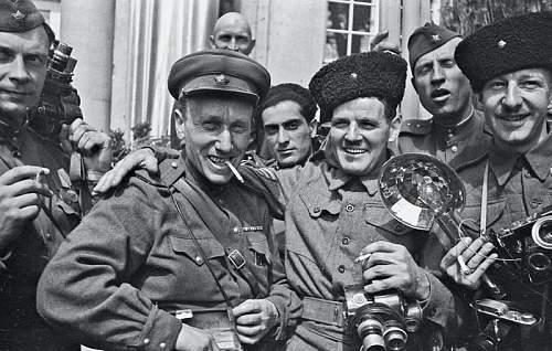 Cameras and insignia of U.S. war photographers