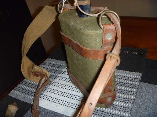 1942 british water bottle and leather harness.