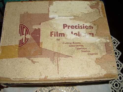 16mm film splicer in box with some diggers