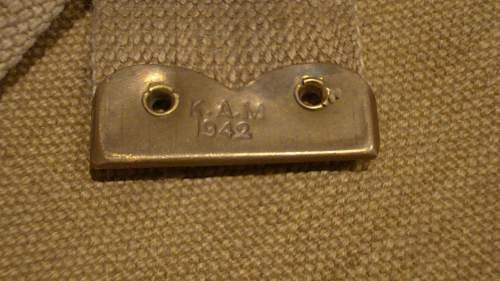 Click image for larger version.  Name:43 Right Shoulder Strap Brass Chape marked 'K.A.M. 1942'.jpg Views:71 Size:225.2 KB ID:657404