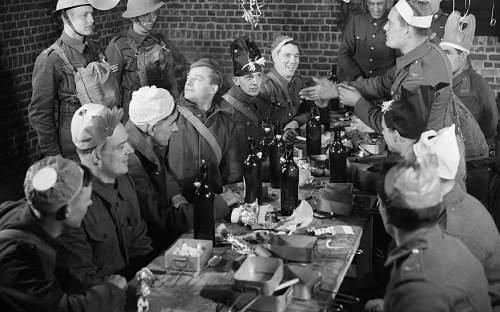 Click image for larger version.  Name:Men of the Border Regiment enjoy Christmas dinner at Mouchin in France, 17 December 1939...jpg Views:588 Size:74.6 KB ID:739486