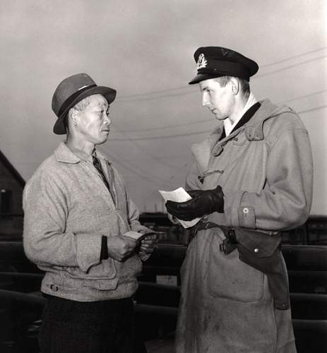 Click image for larger version.  Name:A Japanese-Canadian fisherman is questioned in 1941..jpg Views:112 Size:153.3 KB ID:792097