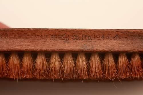 British brush and button stick