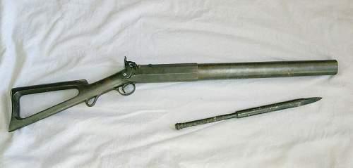 Trying to identify a brass gun stock