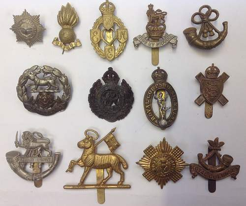 Click image for larger version.  Name:WW1 and WW2 cap badges (2).jpg Views:49 Size:214.9 KB ID:901430