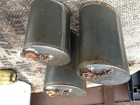 Unidentified oil cans