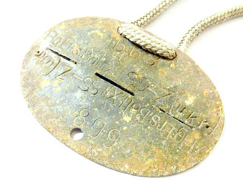 two dog tags - LETT  &  UKR - good or not ...
