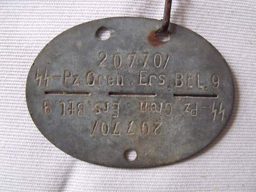 SS dog tag in unexpected location.