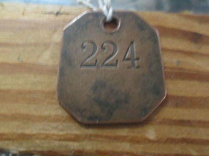 Brass numbered ID Tag ??