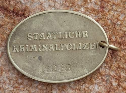Kripo badge, opinions