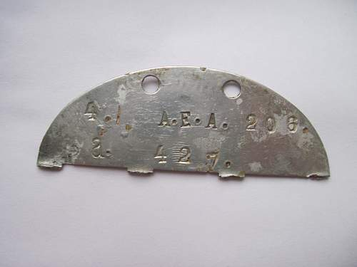 Double sided dog tag, and maybe a commanders?