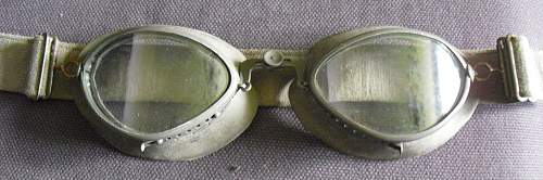 A tin of goggles with spare lens.