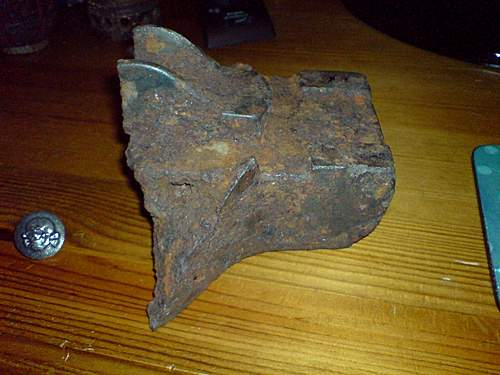 Hi I am new here today ! Tank Track fragment or heavy artillery sight mount partly damaged ??
