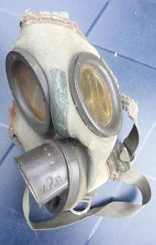 Wehrmacht gas mask and container.