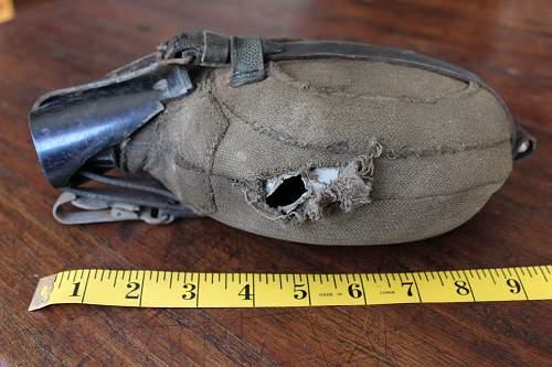 Bullet damaged canteen