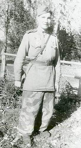 Click image for larger version.  Name:Captured German camo in Soviet soldier.jpg Views:433 Size:43.2 KB ID:538201