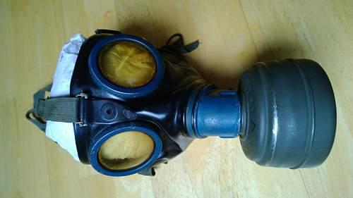 Putting gas masks on styrofoam heads?
