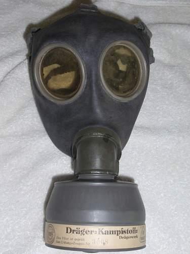 Click image for larger version.  Name:German Gasmask 1939 front.jpg Views:356 Size:196.5 KB ID:718278