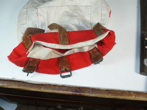 Unknown red & white canvas  bag with 3 leather straps vet bring back
