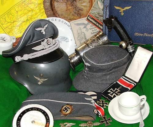 Click image for larger version.  Name:Luftwaffe helmet group 001.jpg Views:36 Size:230.9 KB ID:858437
