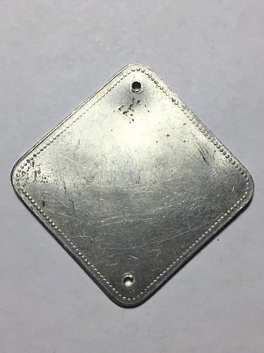 Strange Aluminum German Capture Tag