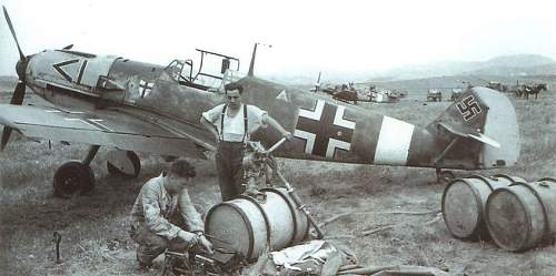 Click image for larger version.  Name:a-khp-4-attached-to-a-200-litre-fuel-drum-in-the-background-several-messerschmitt-bf-109-aircraf.jpg Views:10 Size:84.4 KB ID:997140