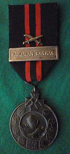 Click image for larger version.  Name:my Commemorative Medal of the Winter War Karjalan Kannas clasp.jpg Views:190 Size:236.7 KB ID:392575