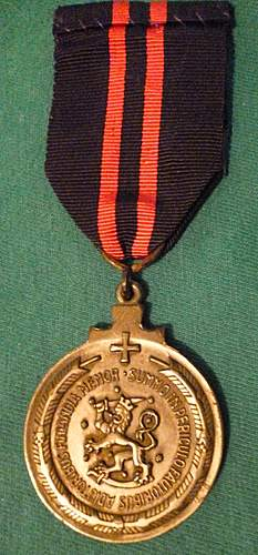 Click image for larger version.  Name:my Finnish Commemmorative Medal of the Winter War for Swedish Volunteers with Lappi clasp back.jpg Views:343 Size:246.5 KB ID:392577