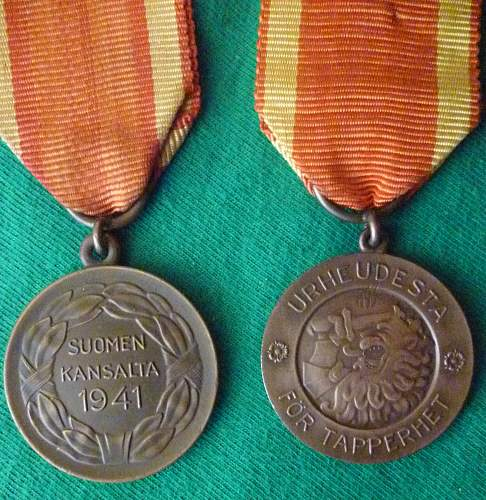 Click image for larger version.  Name:my Finnish Medal of Liberty 2nd class 1941 back and 1939 front.jpg Views:527 Size:225.0 KB ID:409329