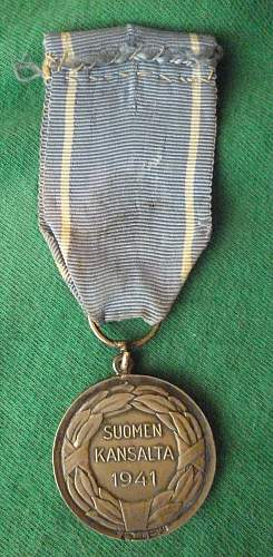 Click image for larger version.  Name:my Finnish Medal of Liberty 1st Class with Red Cross 1941(hallmarked, only 350 issued) back.jpg Views:134 Size:252.0 KB ID:409331
