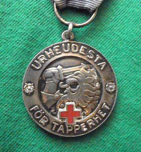 Click image for larger version.  Name:my Finnish Medal of Liberty 1st Class with Red Cross 1941(hallmarked, only 350 issued) close up .jpg Views:168 Size:225.4 KB ID:409332