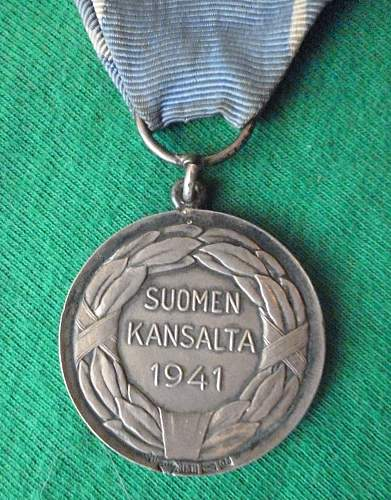 Click image for larger version.  Name:my Finnish Medal of Liberty 1st Class with Red Cross 1941(hallmarked, only 350 issued) close up .jpg Views:132 Size:231.5 KB ID:409333