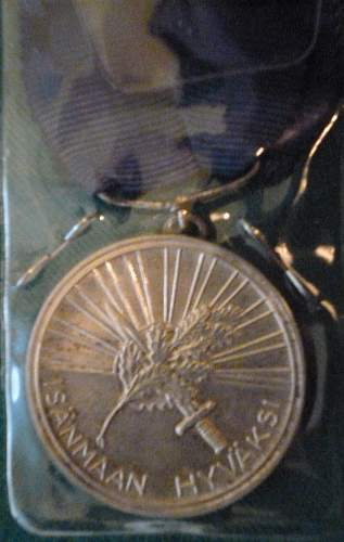Click image for larger version.  Name:my Finnish Medal of the White Rose 1st Class with Gilt Cross close up back.jpg Views:413 Size:225.5 KB ID:424322