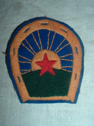 A couple of early cloth insignia
