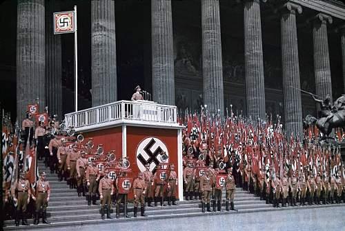 Deutschland Erwache standards on parade. (colour WW2 photo)