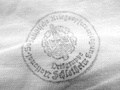 need help iding stamp on my 7 ring NSDAP wall banner