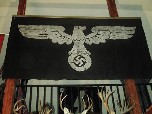 Black flag with silvered eagle and swastika