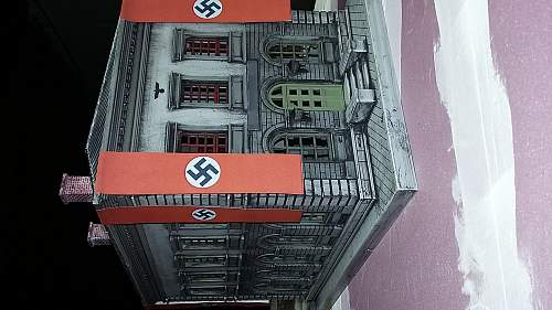 Need opinions on authenticity of buckles,  helmet badge. + an O-SCALE Nazi building