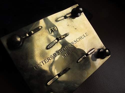 U boat belt buckle in its original box, thats ALL i know.